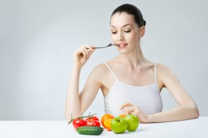 A beautiful slender girl eating healthy food